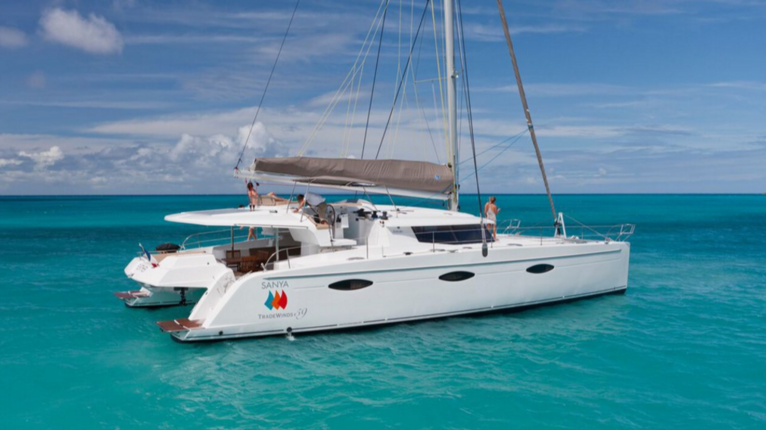 Explore The Beauty Of Caribbean: TradeWinds 59' 5-Cabin Crewed Catamaran Luxury Class