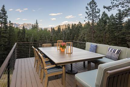 Outdoor deck with railings, table & seating