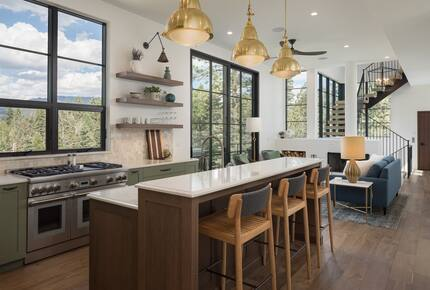 Kitchen island with three stools facing a large window