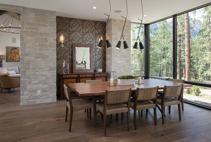 Dining room with table & 8 chairs & floor to ceiling windows