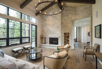 Great room with vaulted ceilings and stone wall fireplace