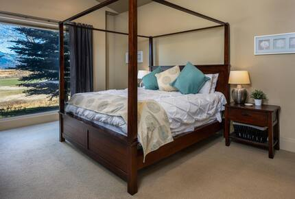 Main level master bedroom with king canopy, four-poster bed