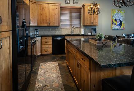 Kitchen with knotty alder cabinets and granite countertops
