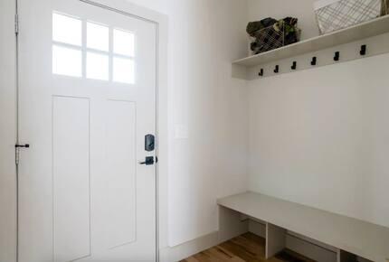 Front door interior entryway with bench