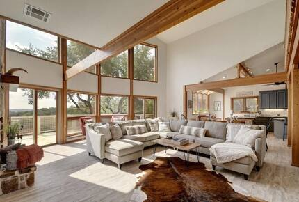 Lodge great room with vaulted ceilings and large windows