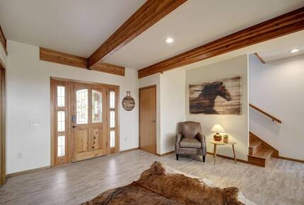 Interior entryway to the lodge with wood door & exposed beam