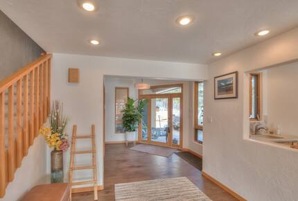Home exchange in La Veta CO, front entryway near staircase and wet bar