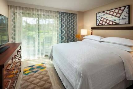 Home Exchange, Sheraton Kaua'i Resort unit, bedroom with king bed
