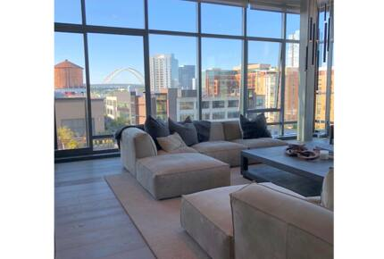 Home exchange in Portland, OR, penthouse living room with big windows