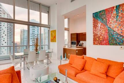 Home exchange in Miami FL, living room with orange couch