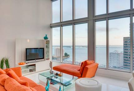 Home exchange in Miami FL, living room with 16 foot windows