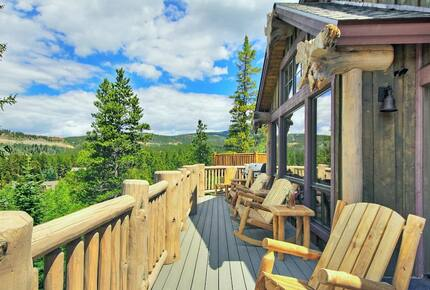 Home exchange in Breckenridge CO, deck with Adirondack-style chairs