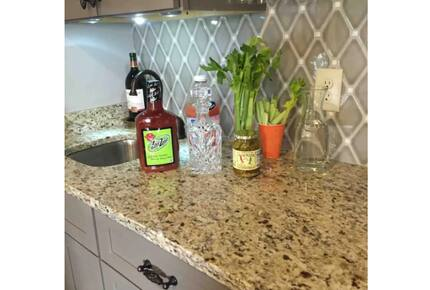 Home exchange in Auburn AL, wet bar with granite countertop