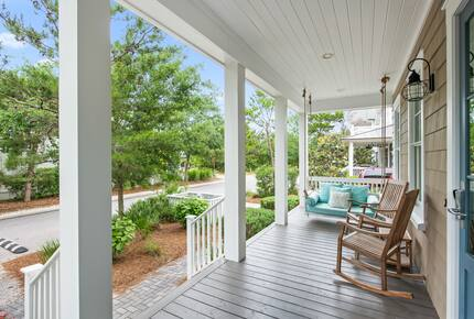 Home exchange in WaterSound FL, front porch with swing & rocking chair