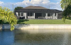 Home exchange in Cape Coral FL on canal, 4 bedroom 3 bath sleeps 8