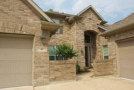 Home exchange in Woodlands TX with stone-front elevation
