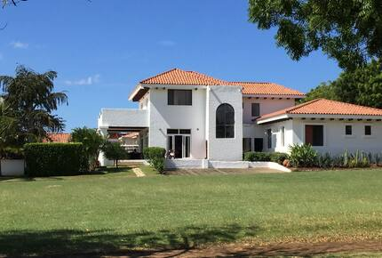 Home exchange at Gran Pacifica, exterior with large green lawn