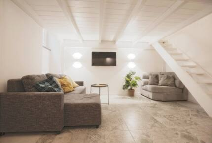Home exchange in Rome Italy, loft living area with pull-out couch
