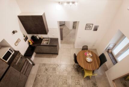 Home exchange in Rome Italy, views of kitchen from the loft above