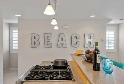 """Home exchange in Oxnard CA with galvanized """"beach"""" letter wall decor"""